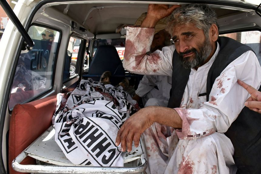 A man mourns the death of a relative after the blast.