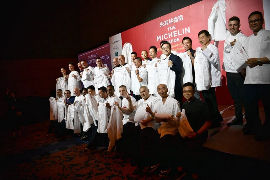 Michelin starred restaurant chefs posing for a group photo during a gala for the Singapore Michelin Guide, on July 25, 2018.