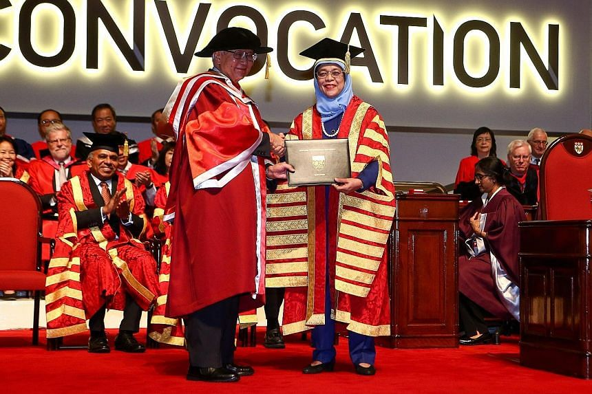 Dr Tony Tan Keng Yam receiving the honorary degree from President Halimah Yacob at Nanyang Technological University yesterday. Former head of civil service Peter Ho was awarded an honorary Doctor of Science. Lee Foundation chairman Lee Seng Tee recei