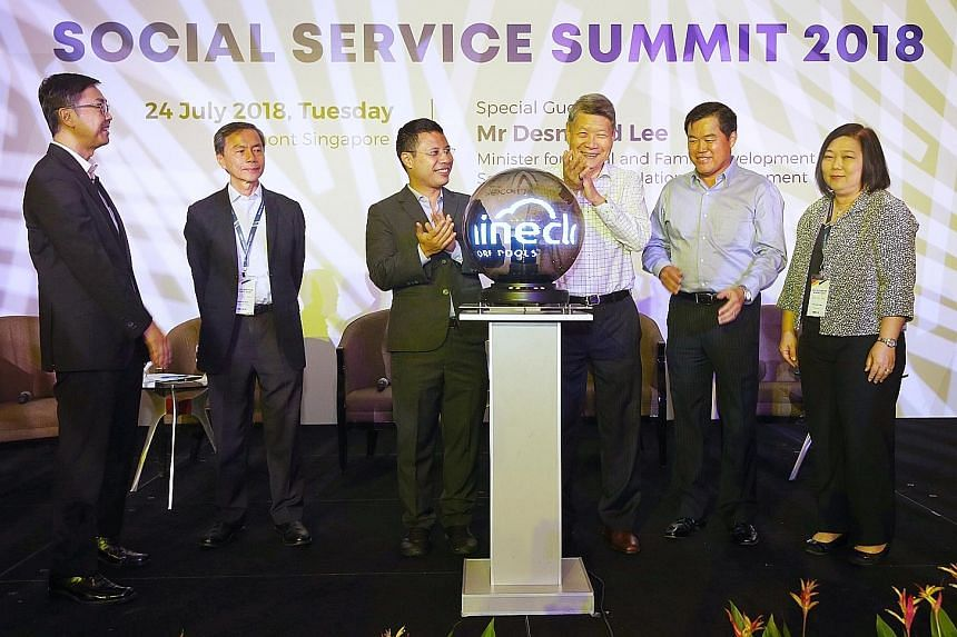 Minister for Social and Family Development and Second Minister for National Development Desmond Lee (third from left) at the launch of the non-profit IT company iShine Cloud, a collaboration between Singapore Pools and NCSS, at the Social Service Sum