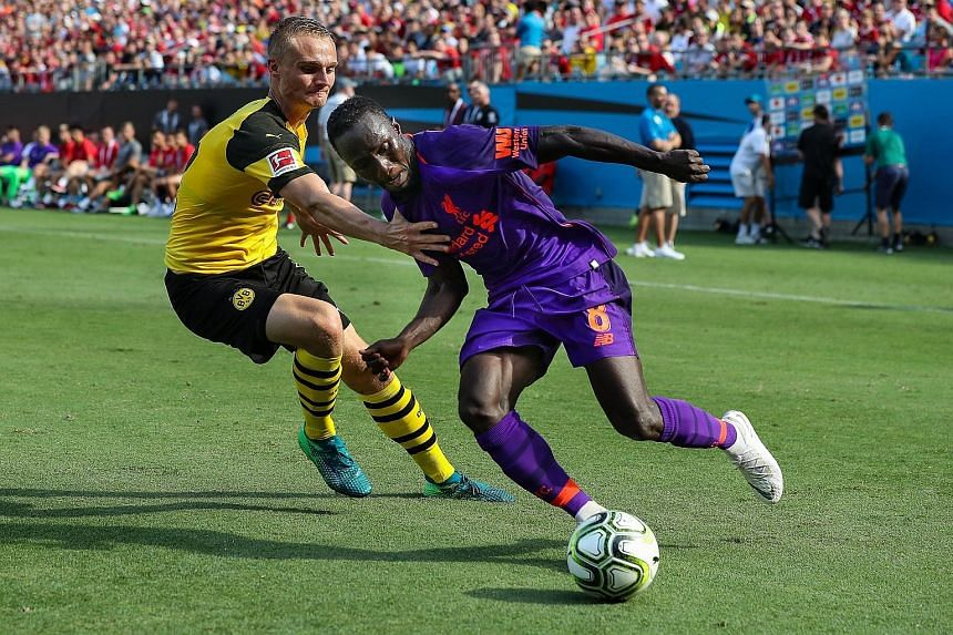 Liverpool midfielder Naby Keita evading Borussia Dortmund's Amos Pieper during the 3-1 loss to the German side in the International Champions Cup match at Charlotte, North Carolina, on Sunday. Manager Jurgen Klopp is hoping that his four signings, wh