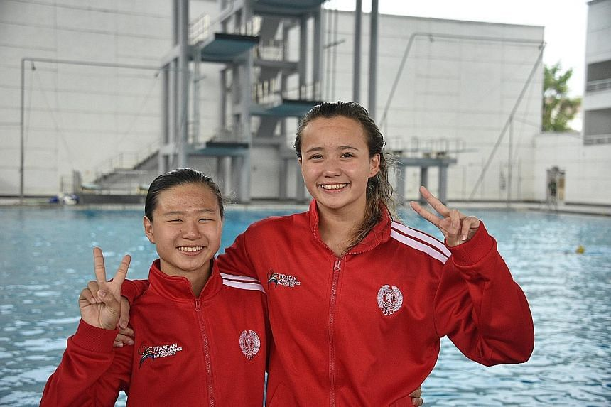 Best friends Elena Pedersen (right) and Claresa Liau, both from Methodist Girls' School, won gold in the 100m backstroke and 200m breaststroke respectively at the Asean Schools Games in Malaysia yesterday.