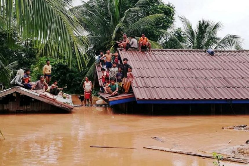 Villagers evacuate after the Xepian-Xe Nam Noy hydropower dam collapsed in Attapeu province, Laos, on July 24, 2018.