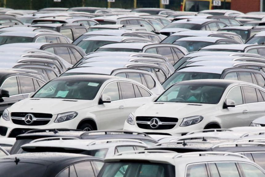 Cars of German car maker Mercedes Benz are parked at the port of Bremerhaven, northern Germany, on July 23, 2017.  The EU is preparing to introduce tariffs on US goods if Washington imposes trade levies on imports of cars.