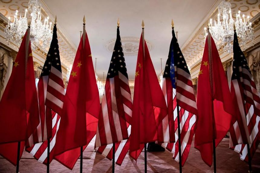 US and Chinese flags are seen as Secretary of State Mike Pompeo and China's Foreign Minister Wang Yi meet at the US Department of State in Washington, DC, on May 23, 2018.