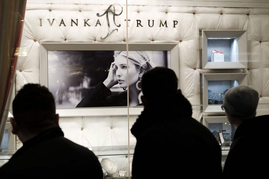 People walking past the Ivanka Trump Collection shop in the lobby at Trump Tower in New York in 2017.