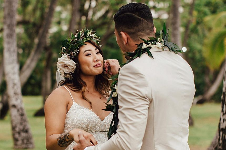 Angela Lee and Bruno Pucci sharing an intimate moment together during their wedding ceremony.
