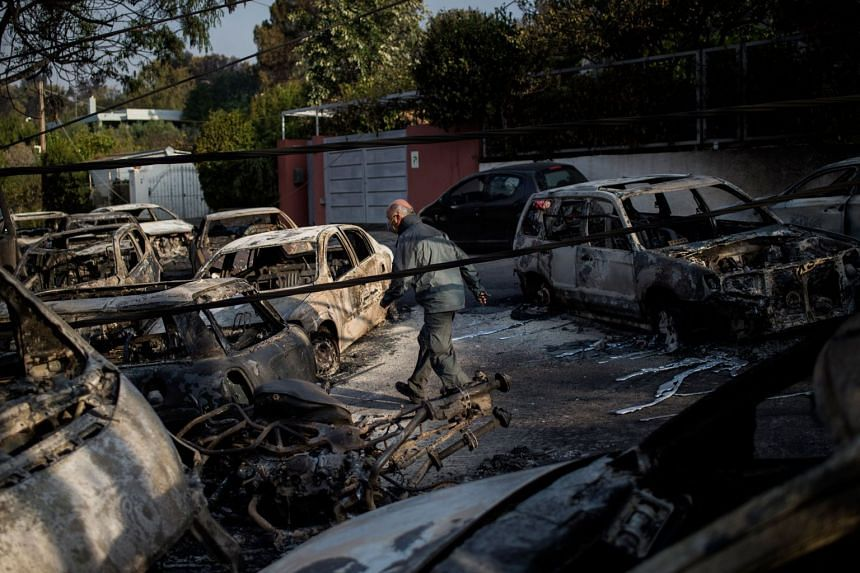 Scores of gutted cars lined streets in the coastal town, east of Athens, melted by the intensity of the heat.
