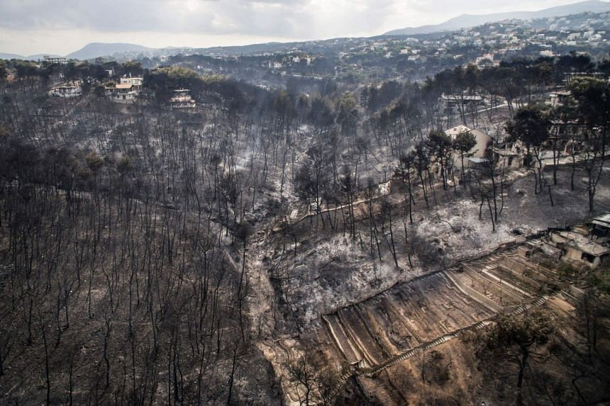 An aerial view shows the damage caused by wildfires near the village of Mati, near Athens, on July 24, 2018.
