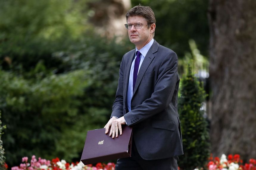 Britain's business minister, Greg Clark, wants to tighten the existing rules, which are limited to large transactions, to cover all British companies including small firms.