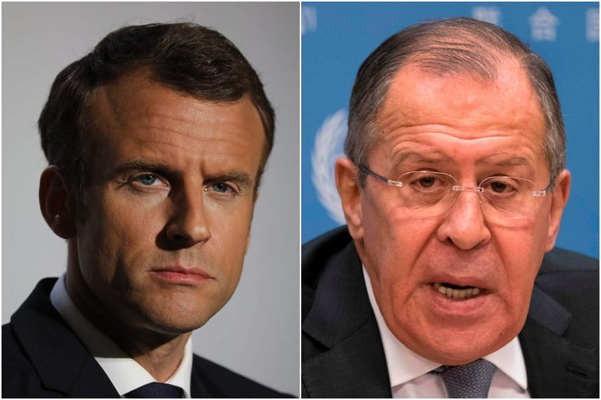 French President Emmanuel Macron (left) and Russian Foreign Minister Sergey Lavrov discussed about the conflicts in Syria and Ukraine in an unannounced meeting, on July 24, 2018.