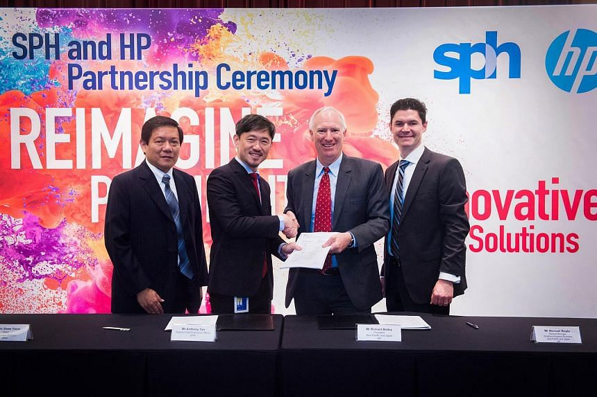 At the signing ceremony at SPH's News Centre auditorium on July 25, 2018, were SPH senior vice-president of production Lim Swee Yeow (from left), SPH deputy CEO Anthony Tan, HP president of Asia-Pacific and Japan Richard Bailey and vice-president Mic