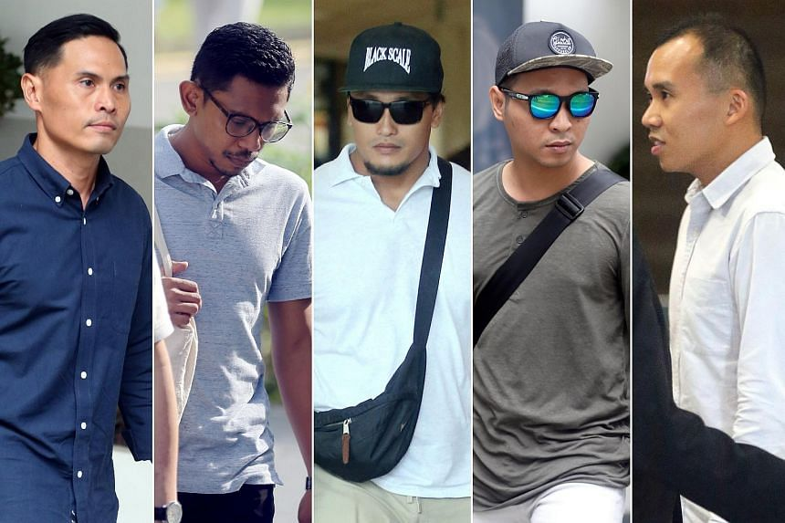 The five SCDF personnel charged on July 25 are Nazhan Mohamed Nazi (from left), Mohamed Farid Mohamed Saleh, Mohammad Nur Fatwa Mahmood, Adighazali Suhaimi and Kenneth Chong Chee Boon.