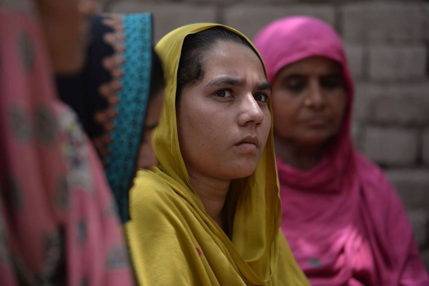 Villagers in Mohri Pur listen to a Pakistani social worker trying to convince them to vote ahead of the polls.