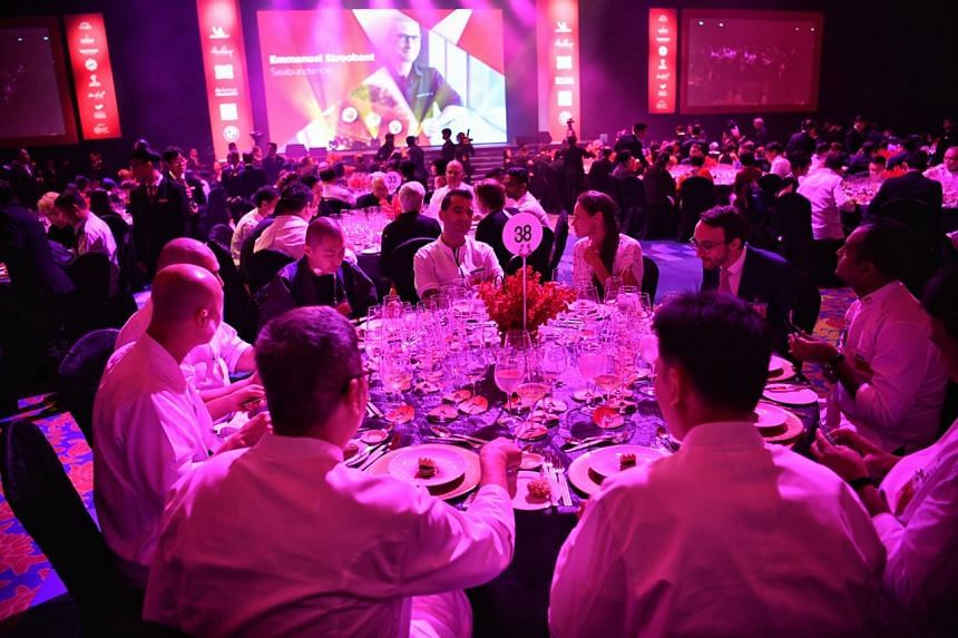 """Chefs enjoying the gala dinner with the theme of """"The Past Through Tomorrow"""" at Resorts World Sentosa on July 25, 2018."""