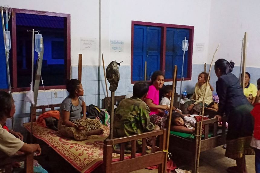 Villagers seeking refuge at an evacuation centre after they were forced out of their homes by flood waters.