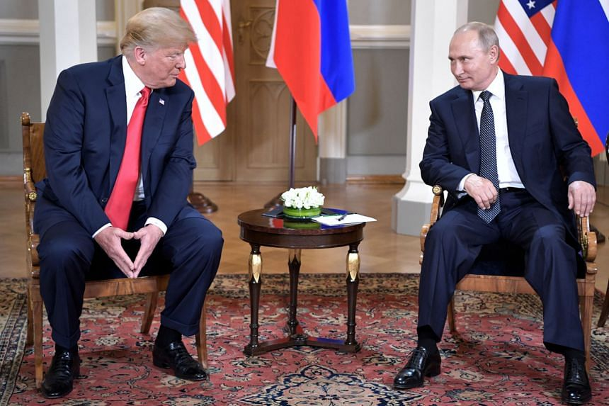 US President Donald Trump and Russian President Vladimir Putin at their summit in Helsinki, Finland, on July 16. The writer says that while the US President was seen by the Washington policy establishment to be disgracing himself on an international