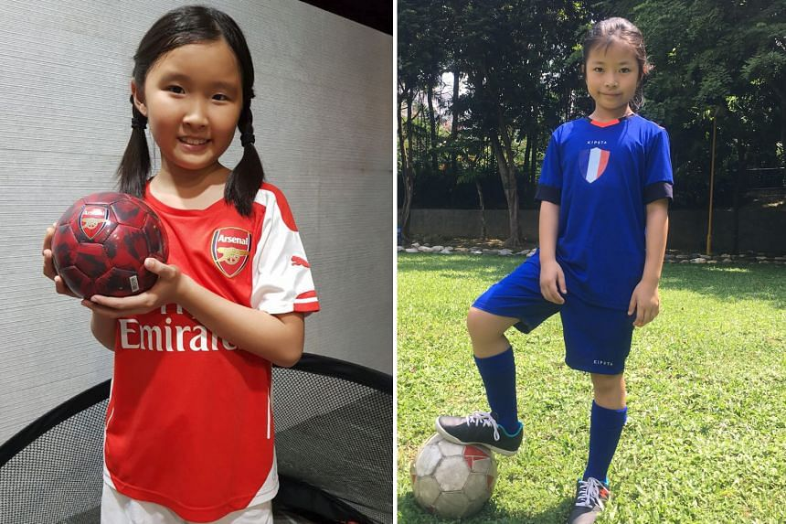 Chae Min wearing her favourite Gunners jersey. Sarah-Ann Seet (below, left) and Min will walk the Atletico Madrid and Arsenal players onto the National Stadium pitch first tomorrow and then on Saturday respectively.