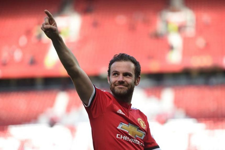 Manchester United's Spanish midfielder Juan Mata waves to the crowd at the end of the English Premier League match between Manchester United and Watford at Old Trafford in Manchester, north west England, on May 13, 2018.