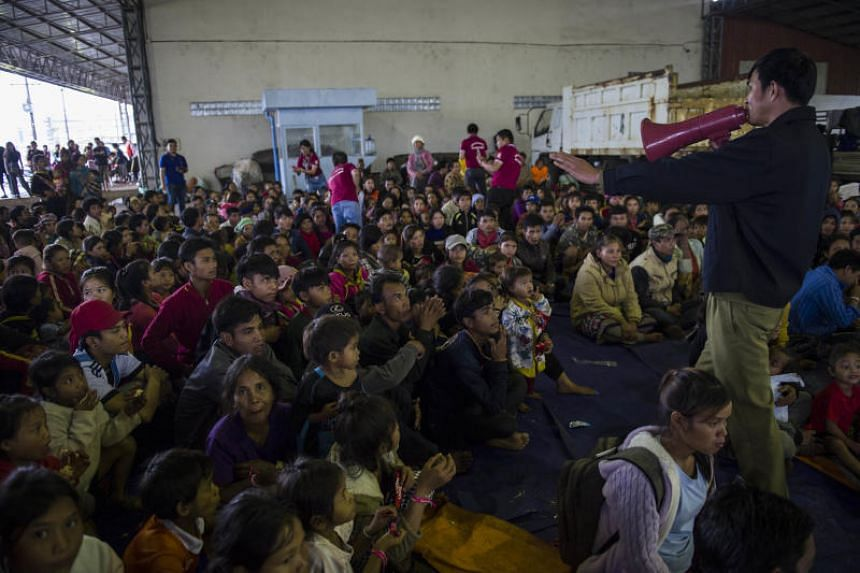 Residents displaced by massive flood waters from the collapsed dam seek shelter in Paksong town in Champasak province, on July 25, 2018.