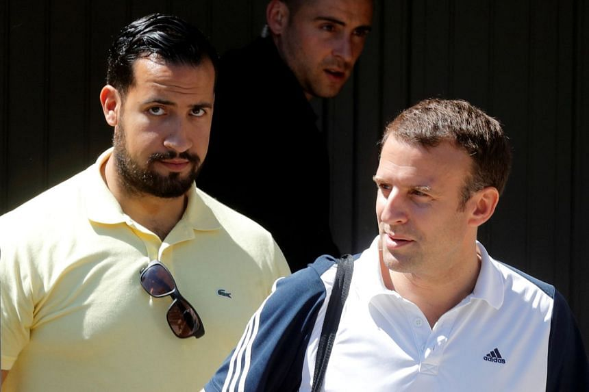 Macron (right) is flanked by Benalla as he leaves his home to play tennis in Le Touquet, France, in 2017.