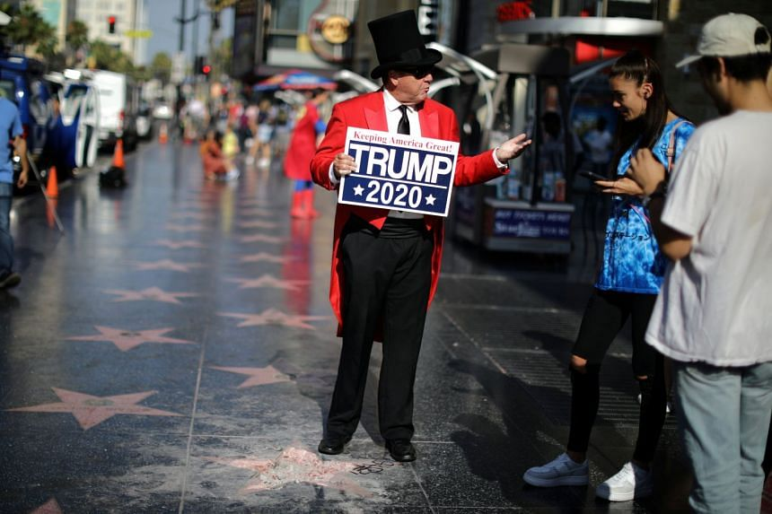 Greg Donovan, 58, stands on Trump's vandalised star on the Hollywood Walk of Fame.