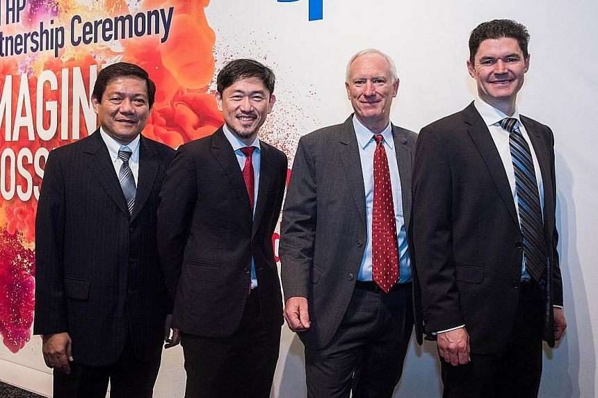 (From left) SPH senior vice-president of production Lim Swee Yeow, SPH deputy CEO Anthony Tan, HP president of Asia Pacific and Japan Richard Bailey, and vice-president Michael Boyle at yesterday's event.