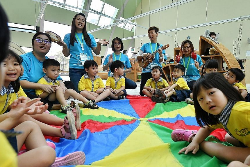 Teachers and children during a sing-along session at the Atelier Loft of the Skool4Kidz's campus yesterday. Minister for Social and Family Development Desmond Lee was there to officiate the opening of Skool4Kidz's large childcare centre at Sengkang R