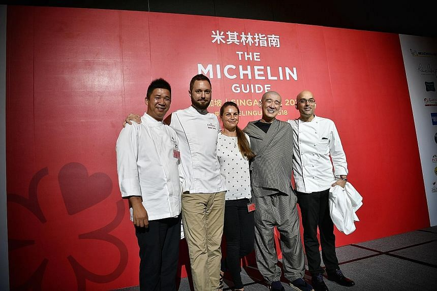 Above: Celebrating their restaurants' new Michelin stars are (from left) chef Lam Hon Tim from Jiang-Nan Chun, chef Mathieu Escoffier from Ma Cuisine, Ms Katrina Wheeldon from Burnt Ends, chef Tomoo Kimura from Sushi Kimura and chef Ivan Brehm from N