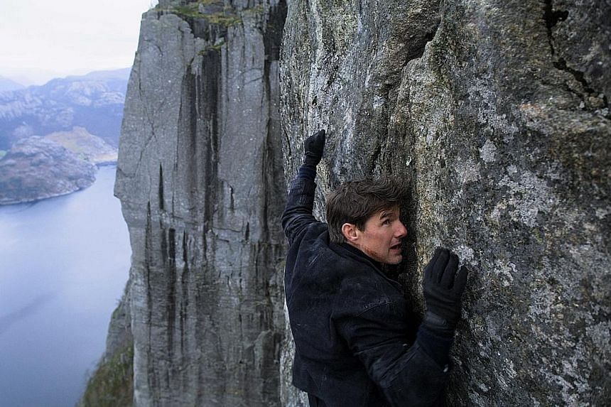 Tom Cruise in a spectacular scenic stunt.