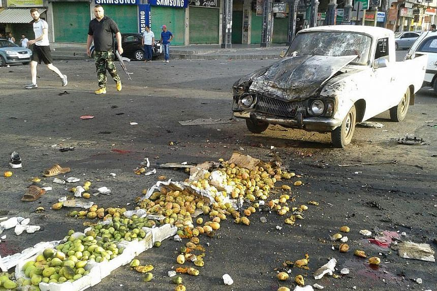 Syrian state television aired images of scattered vegetables and damaged cars on the streets of Sweida city, where four suicide bombers struck yesterday.