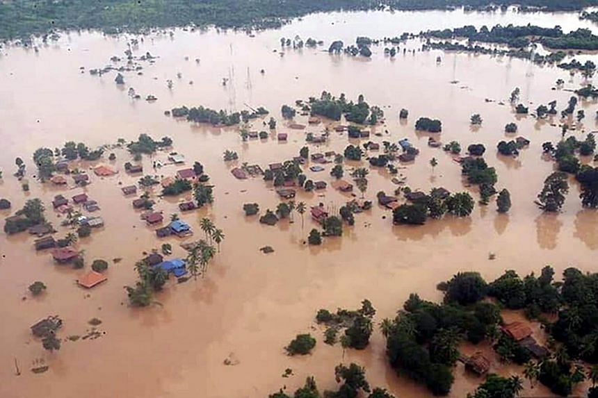 Aerial view of houses submerged by floodwaters after the Xe Pian Xe Nam Noy dam collapsed in villages near Attapeu province, Laos, on July 24, 2018.