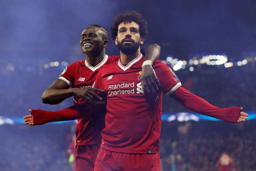 Liverpool's Mohamed Salah celebrates scoring their first goal with Sadio Mane at the Champions League Quarter Final in Manchester, Britain, on April 10, 2018.