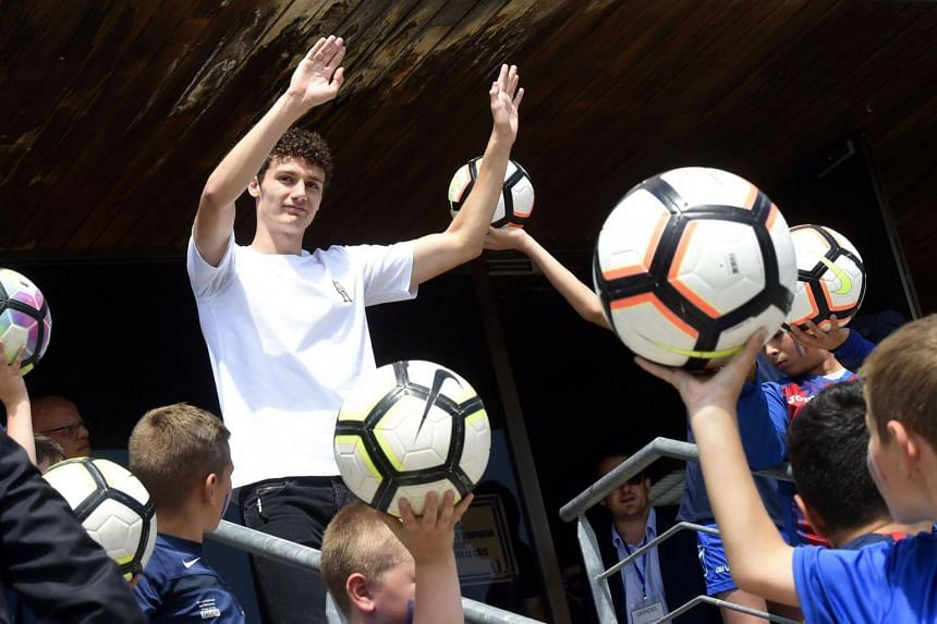 Benjamin Pavard waves to the crowd in his home town of Jeumont, northern France, on July 18, 2018, three days after French players won the Russia 2018 World Cup final football match.