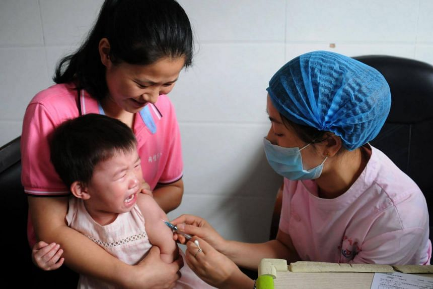 A child receiving a vaccination shot at the local disease control and prevention center in Jiujiang in China's central Jiangxi province, on July 24, 2018.