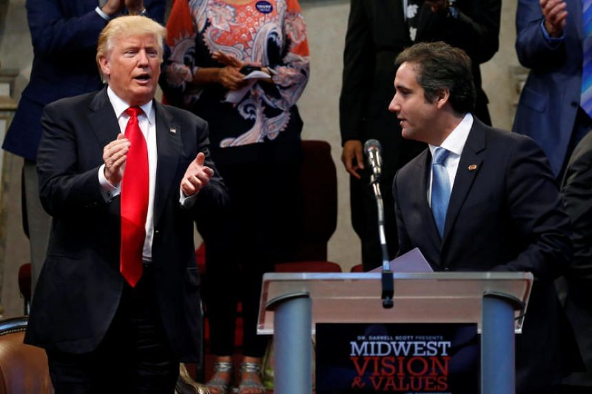 Republican presidential nominee Donald Trump listens as his personal attorney Michael Cohen delivers remarks on his behalf during a campaign stop at the New Spirit Revival Center church in Cleveland Heights, Ohio, US, on Sept 21, 2016.