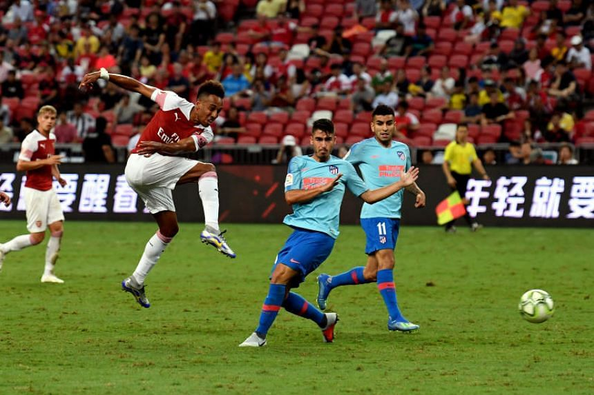Arsenal's Pierre-Emerick Aubameyang takes a shot at goal during their International Champions Cup match at the National Stadium in Singapore on July 26, 2018.