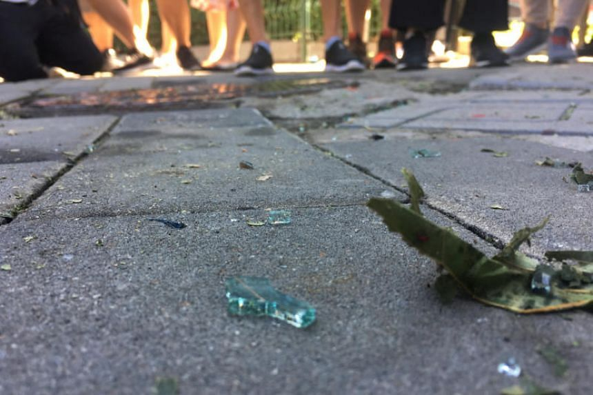 Broken glass is seen near the US embassy in Beijing on July 26, 2018.