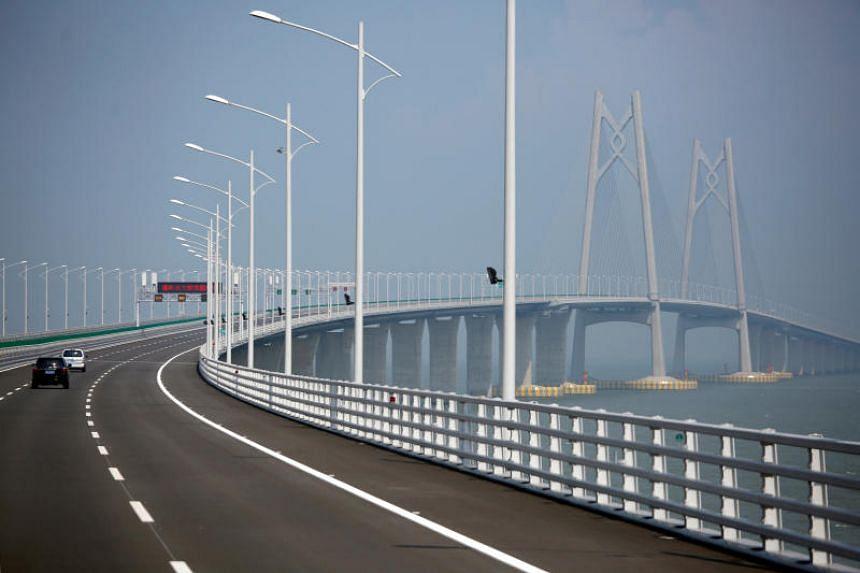 Cars drive on a section of the Hong Kong-Zhuhai-Macau Bridge on March 28, 2018.
