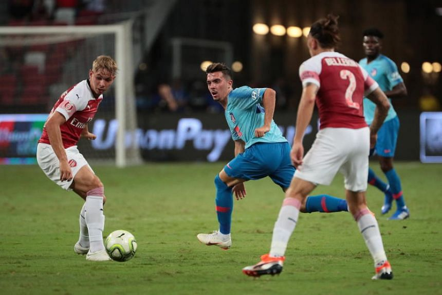 Atletico de Madrid's Joaquin Munoz in action against Arsenal's Emile Smith Rowe and Hector Bellerin during the International Champions Cup match at the National Stadium in Singapore on July 26, 2018.