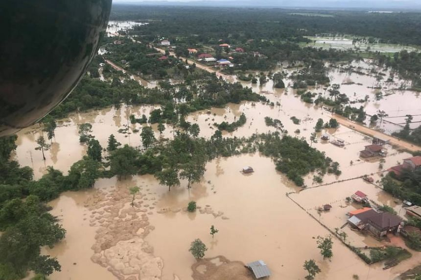 A photo taken on July 25, 2018, shows an aerial view of the flooded area in Sanamxai in Laos' Attapeu province after a dam collapsed on July 23, 2018.