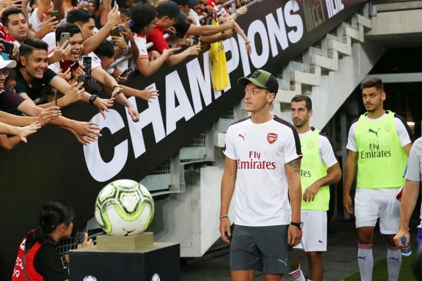 Arsenal's Mesut Ozil walking out of the tunnel before the start of their  International Champions Cup match at the National Stadium in Singapore on July 26, 2018.