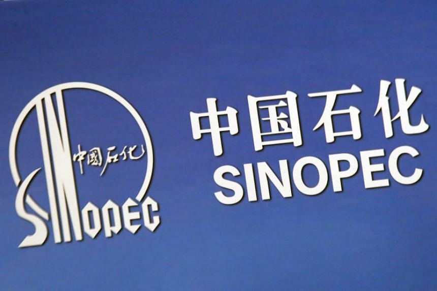 The company logo of China's state-owned oil company Sinopec is displayed at a news conference in Hong Kong on March 26, 2018.