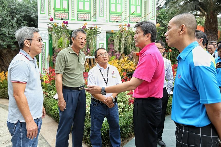 Labour chief Ng Chee Meng (second right) commended Gardens by the Bay for voluntarily raising the retirement age of its workers to 65, from the statutory requirement of 62.