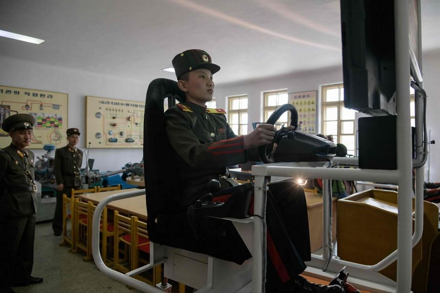 A student driving a military vehicle on a simulator at the Mangyongdae Revolutionary School outside Pyongyang, North Korea.