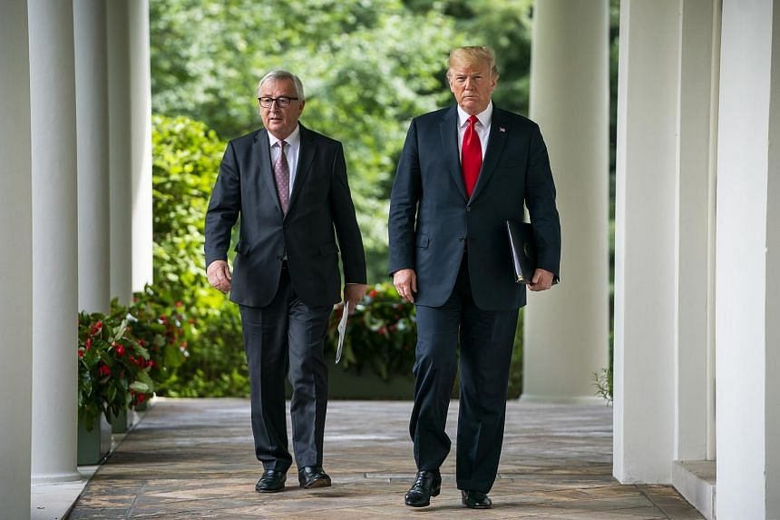 US President Donald Trump (right) and European Commission President Jean-Claude Juncker walk down the Colonnade for a joint statement in the Rose Garden of the the White House in Washington on July 25, 2018.