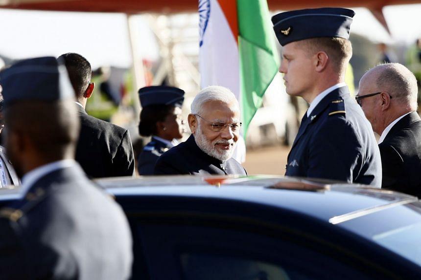 Modi (centre) arriving in Pretoria, South Africa, on July 25, 2018.
