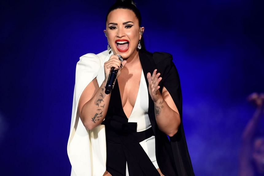 Pop singer Demi Lovato, seen here performing in Lisbon last month, was recently hospitalised for a drug overdose.