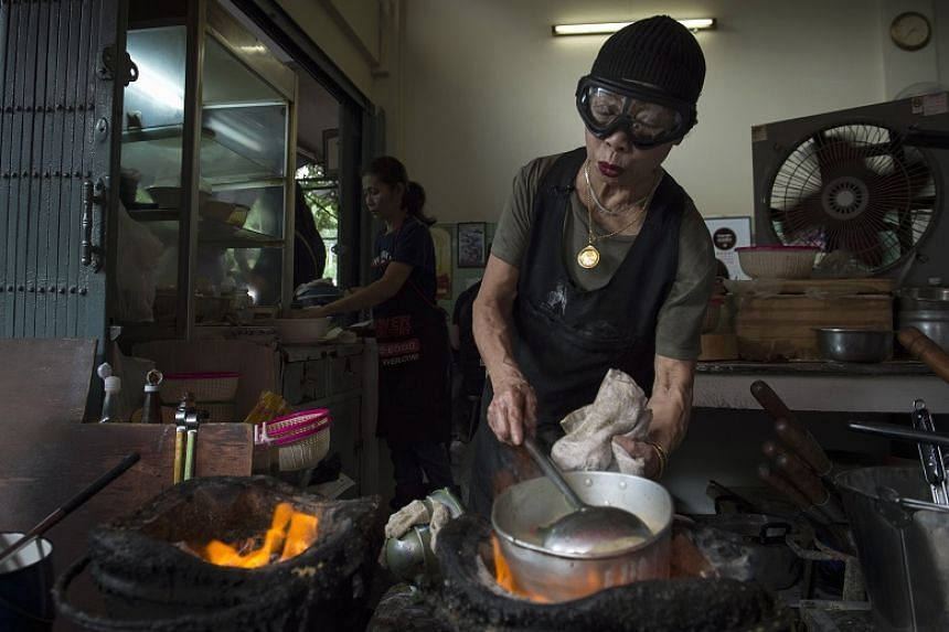 Jay Fai prepares a spicy soup in her restaurant, a day after her street-side eatery was recognised with a one-star Michelin guide, in Bangkok on December 7, 2017.