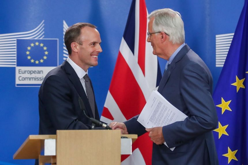 Dominic Raab (left) and Michel Barnier at the end of a final round of talks in Brussels, Belgium.